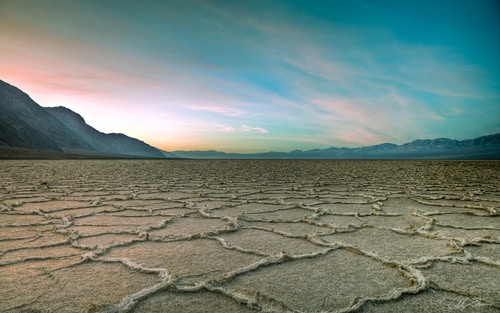 Sunrise - Death Valley California's Badwater salt pan By Stross Arts