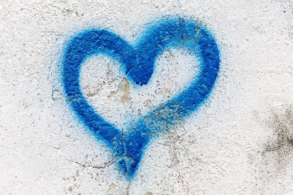 2-heart-graffiti-on-a-rendered-brick-wall-background