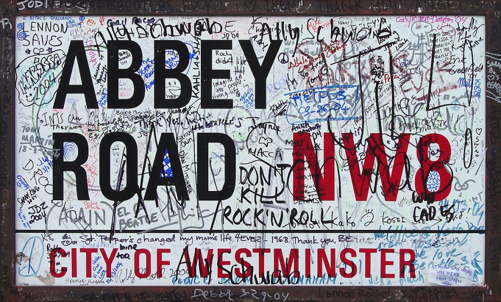 an Abbey Road sign cool graffiti