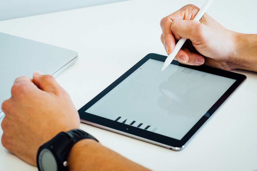 Designer performing graphic design basics using a tablet