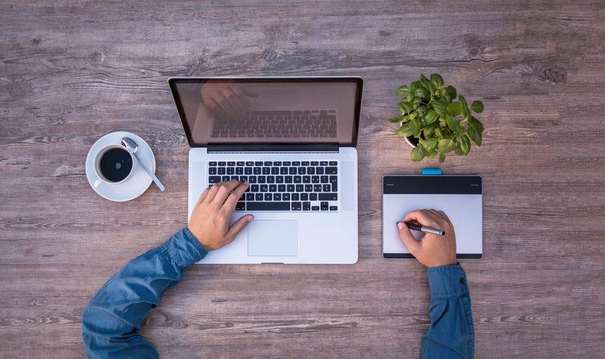 Man doing graphics design using a laptop